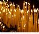 Что означает свечка, которую верующие зажигают перед священным образом в храме?